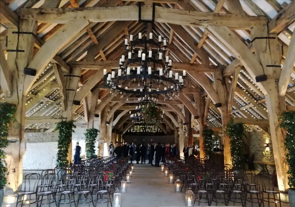 The Tithe Barn, Bolton Abbey, set up for a wedding as guests arrive.