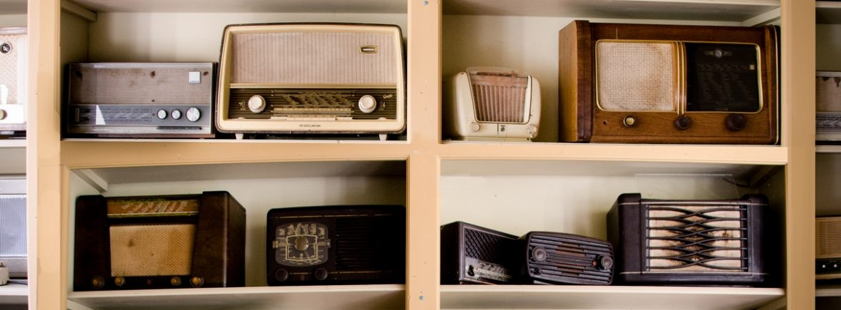 India Rose Strings quartet, trio, duo and singer play vintage jazz and contemporary music - assortment of old radios on shelf